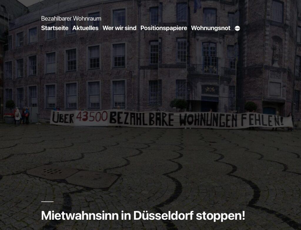Aktionsfoto des Düsseldorfer Bündnisses für bezahlbaren Wohnraum